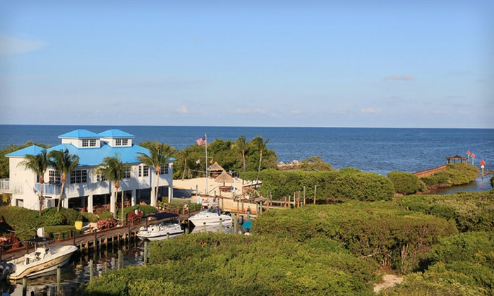 Ocean Pointe Suites at Key Largo - Key Largo, FL: One- or Two-Night Stay with Breakfast, Champagne, and Kayak Rental at Ocean Pointe Suites at Key Largo