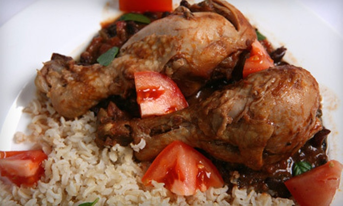 Jamaica Gates Caribbean Cuisine - West Arlington: Dinner for Two or Four or $7 for $14 Worth of Lunch at Jamaica Gates Caribbean Cuisine in Arlington