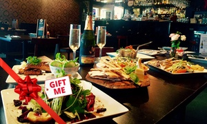 The Artel Lounge & Bar: Three-Course Gourmet Dinner with Wine for Two ($59) or Four People ($115) at The Artel Lounge and Bar (Up to $262 Value)