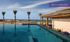 Al Maeda at Double Tree by Hilton Hotel Dubai Jumeirah Beach: Saturday Arabic Brunch with Drinks, Pool and Beach Access for Up to Four at Al Maeda Restaurant (Up to 43% Off)