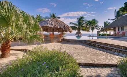groupon daily deal - 4- or 6-Night Stay for Two in an Ocean-View or Beachfront Room or 7-Night Package at Almond Beach Resort & Spa in Belize