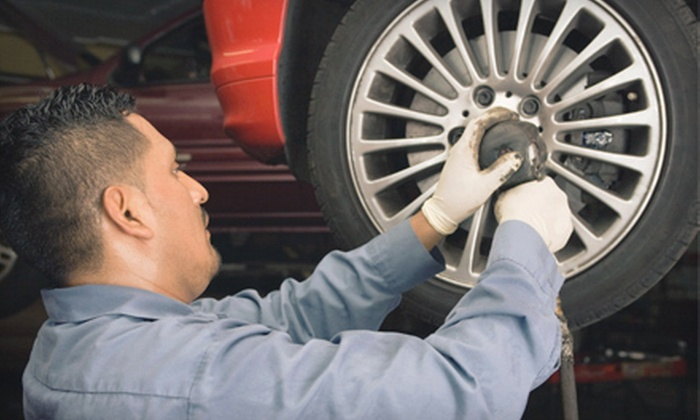Caroline Tire Company - Okeechobee Garden Estates: $39 for a Three-Part Fuel-Induction Service with a Tire Rotation and Inspection at Caroline Tire Company ($129 Value)