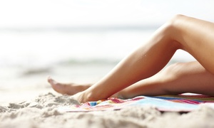 Ultimate Exposure Tanning Centers: UV or Spray Tans or Three Months of Unlimited Red-Light Treatments at Ultimate Exposure Tanning Centers (85% Off)