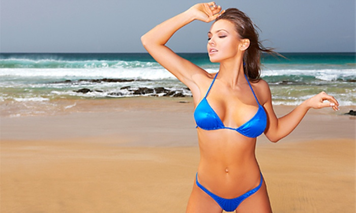 Tan Dallas - Dallas: 30 UV Tans in One Month, or Two VersaSpa Spray-Tanning Sessions at Tan Dallas (Up to 88% Off)