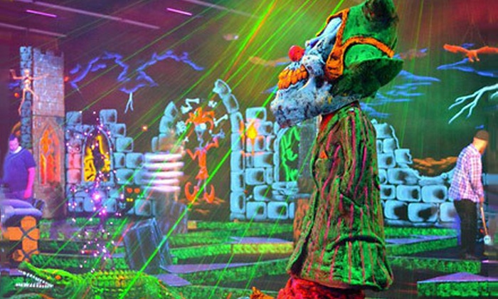 Monster Mini Golf  - North Meadows: $16 for Four Black-Light Mini-Golf Passes at Monster Mini Golf in Windsor Locks (Up to $32 Value)