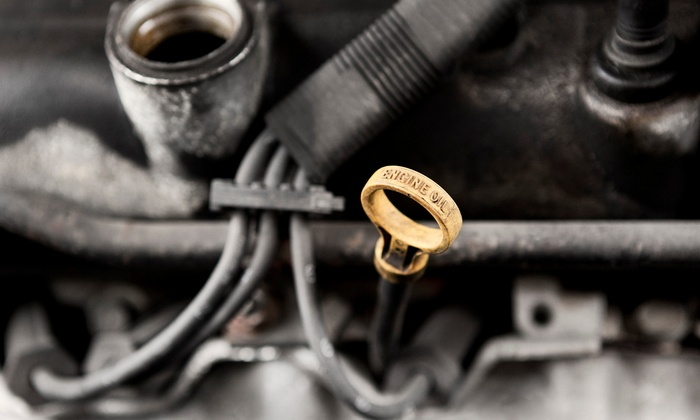 AAMCO - Alban Hills: AC Service and Oil Change or Front or Rear Brake Service at AAMCO (Up to 65% Off)