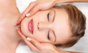 Massage Motu: 50-Minute Custom Facial with Choice of Upgrades, or Both with Body Wrap at Massage Motu (Up to 48% Off)