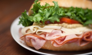 Pickle Jar Deli: $12 for Four Groupons, Each Good for $8 Worth of Sandwiches at Pickle Jar Deli ($32 Total Value)