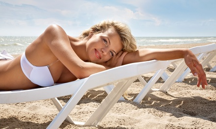 One Custom Airbrush Tan, One Week of Unlimited Tanning, or Two Spray Tans at The Tanning Spa (Up to 75% Off)