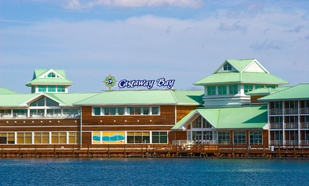 groupon daily deal - Stay with Water-Park Passes at Castaway Bay in Sandusky, OH; Dates into March Available
