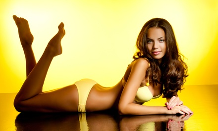 One Month of Bed Tanning, One or Three Spray Tans, or Light-Therapy Sessions at Suntanz of Tulsa (Up to 58% Off)