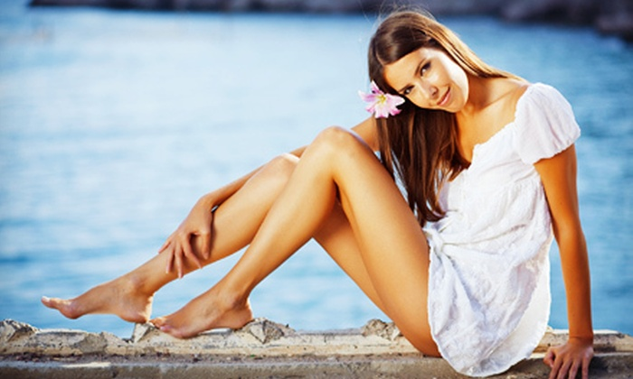 Sandy Beaches - Multiple Locations: Two Weeks of Unlimited Tanning, Two Mystic Spray Tans, or Two Bronze Cocktails at Sandy Beaches Tanning (Up to 60% Off)