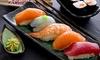 Menu con sushi e vino in centro
