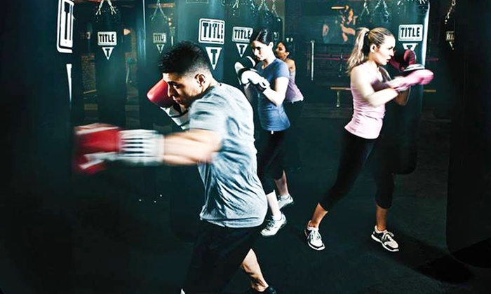 TITLE Boxing Club - Multiple Locations: Two Weeks of Boxing Classes or One-Month Membership to TITLE Boxing Club (Up to 59% Off)