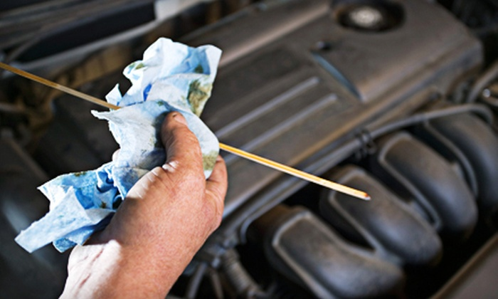 Auto & Tire Service Specialists - Firestone Park: One or Three Oil Changes, or an Oil Change and Inspection Package at Auto & Tire Service Specialists (Up to 62% Off)