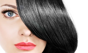 All Dolled Up Salons and Stores: $136 for a Hair-Straightening Treatment at All Dolled Up Salons and Stores ($300 Value)