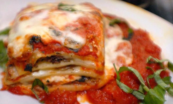 Papa Vito's Italian Restaurant - Cocoa Beach-Cape Canaveral: Gourmet-Pizza Meal for Two or Four, or Italian Food for Two or More at Papa Vito's Italian Restaurant (Up to 58% Off)