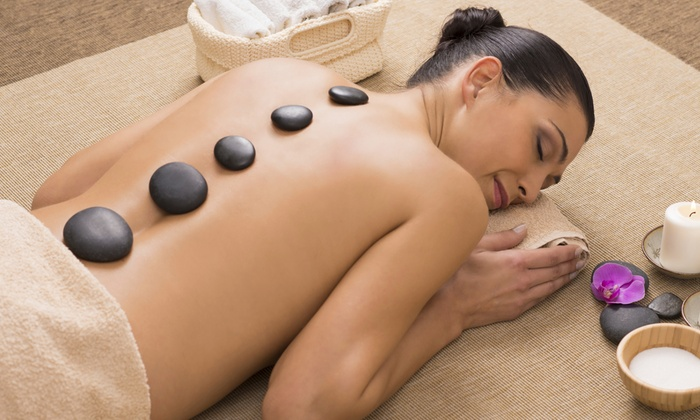 Believe It LTD - Howard: 60- or 90-Minute Hot-Stone Massage with Lavender Essential Oils and a Treat at Believe It LTD (Up to 59% Off)