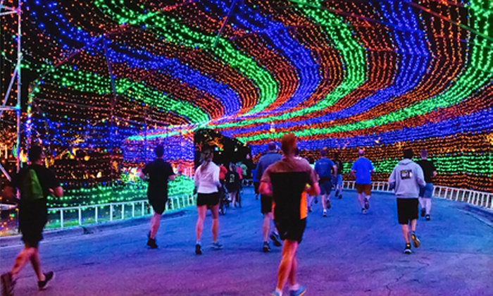 The Rave Run 5K - Central Industrial District: $27 for Nighttime 5K Light Show: Entry for One, Glow Gear, & After-Party from The Rave Run on Friday, May 17 ($60 Value)
