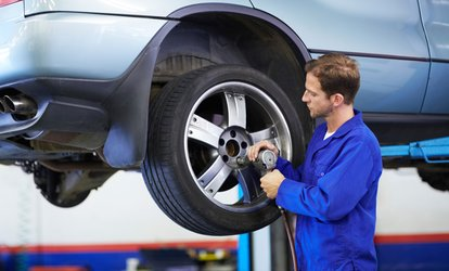 image for Wheel Alignment or Front End Alignment and Tire Rotation at Express Oil Change & Tire Engineers (Up to 44% Off)
