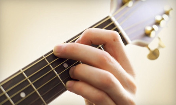 American Guitar Academy - Multiple Locations: Four Private Guitar Lessons for One or Two with Free Lesson e-Book at American Guitar Academy (Up to 62% Off)