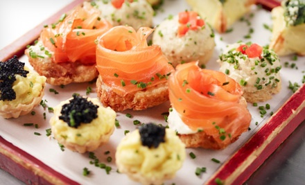 Dinner for 2 with Caviar, Vodka, Champagne, and Entrees, or a Vodka Tasting for 2 or 10 at Pravda (Up to 57% Off)