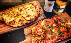 Indulge Bistro & Wine Bar: $22 for One Bottle of Wine and Flatbread at Indulge Bistro and Wine Bar ($41 Value)