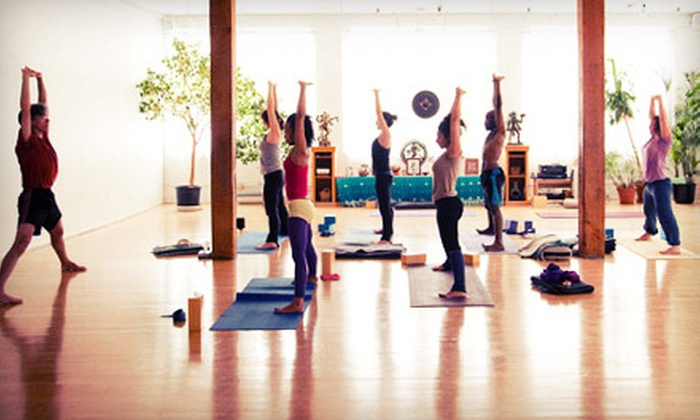 Moksha Yoga Center - Multiple Locations: $49 for 10 Classes at Moksha Yoga Center (Up to $140 Value)