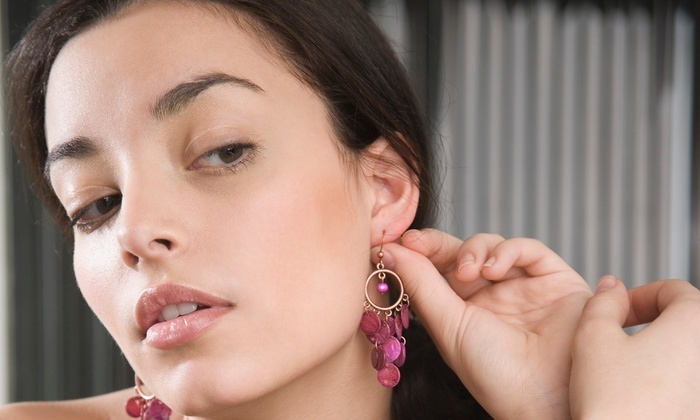 Salon Uptown Downtown - Downtown Bradenton: $15 for Ear Piercing with Starter Studs at Salon Uptown Downtown ($35 Value)