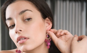 Salon Uptown Downtown: $15 for Ear Piercing with Starter Studs at Salon Uptown Downtown ($35 Value)