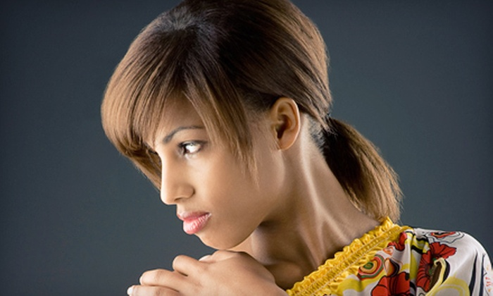 Hair Fetish Barber Shop and Salon - Milford Mill: Haircut Package with Option for Partial Highlights, or Sew-In Weave at Hair Fetish Barber Shop and Salon (Up to 72% Off)