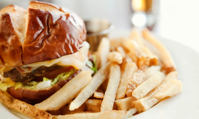 Left of Centre Sports Cafe - Downtown New Rochelle: American Meal with Appetizers, Entrees, and Beer for Two or Four at Left of Centre Sports Cafe (Up to 63% Off)