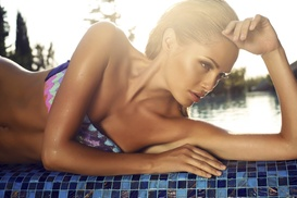 The Stylists Salon: AED 120 for a Full-Body St. Tropez Spray Tan with a Full-Body Scrub at The Stylists Salon (55% Off)