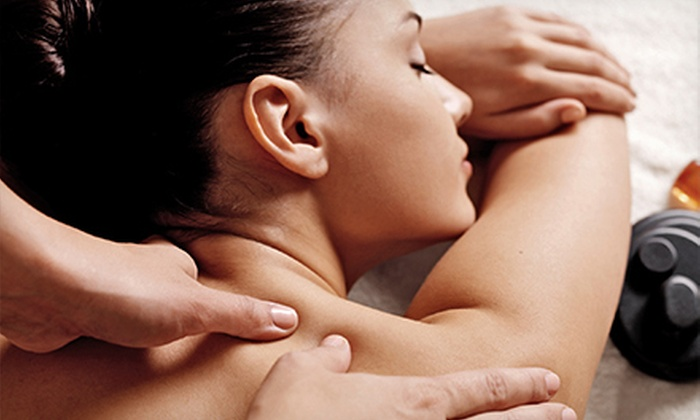Escape Salon and Spa - Glen Ellyn: $49 for One-Hour Hot-Stone or Bamboo Massage at Escape Salon and Spa ($120 Value)