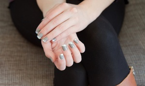 Oui Salon and Spa: Deluxe Manicure with Gel Polish or Deluxe Pedicure at Oui Salon and Spa (Up to 44% Off)
