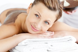 Zara Beauty and Spa: Body Scrub or Hydrating Body Wrap with Optional Essential Facial at Zara Beauty and Spa (Up to 57% Off)