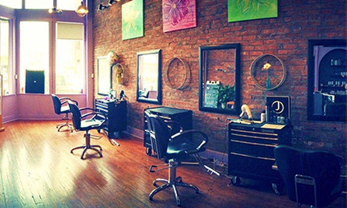 Voda Hair Design - Olde Town East: Haircut, Conditioning, and Blowout with Optional Partial Highlights at Voda Hair Design (65% Off)