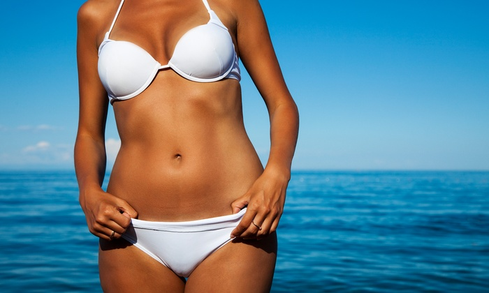 Caribbean Tans - Caribbean Tans: One or Two Months Unlimited Bed or Booth Tanning or Three Mystic Spray Tans at Caribbean Tans (Up to 83% Off)