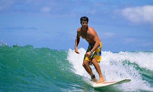 Bautismo de surf para dos personas en la playa de Las Canteras por 19,90 €