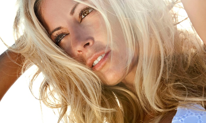 Sunbright Tanning Salon - Bloom Crossing: $25 for Two Mystic Spray Tans or One Month of Silver-Level UV Tanning at Sunbright Tanning Salon ($52 Value)