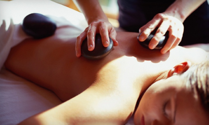 WorkWell Austin - South River City: Customized Massage, Hot-Stone Massage, or 50- or 80-Minute Couples Massages at WorkWell Austin (Up to 55% Off)