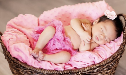 $99 for Baby's 1st Year Photo Package with Five Sessions and $375 in Print Credits from ultra-spective ($700 Value)