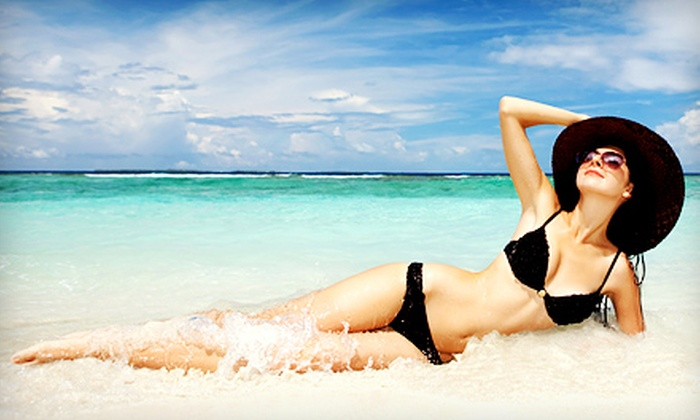 Extreme Sun Capsule - Multiple Locations: One Month of Unlimited Level 1 UV Tanning or Three or Five Mystic Spray Tans at Extreme Sun Capsule (Up to 63% Off)