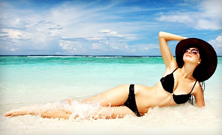 One Month of Unlimited Level 1 UV Tanning or Three or Five Mystic Spray Tans at Extreme Sun Capsule (Up to 63% Off)