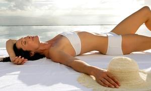 NY Sun Club: $26 for 1 Week of UV Tanning, 2 Mystic HDs, or 1 Custom Spray Tan at NY Sun Club (Up to $147 Value)