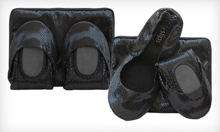 Black Snakeskin CitySlips Foldable Flats: $15 for Black Snakeskin CitySlips Foldable Flats in S–XL and Matching Carrying Pouch ($33.95 List Price). Free Shipping.