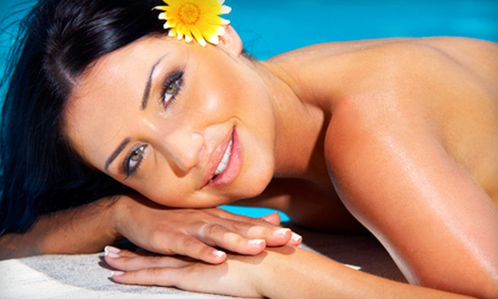 Sun and Sea Tanning - Second Ward: One Month of Unlimited UV Bed Tanning or Three or Five Mystic Tan Spray Tans at Sun and Sea Tanning (Up to 55% Off)