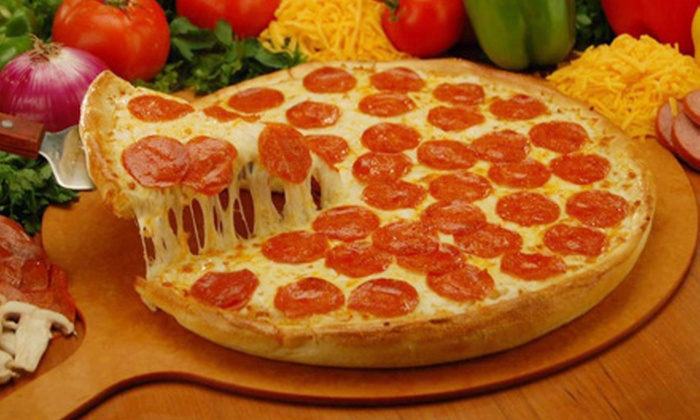 Simple Simon's Pizza - Multiple Locations: Pizza, Calzones, Wings, and Drinks for Up to Four or Eight People at Simple Simon's Pizza (Half Off)