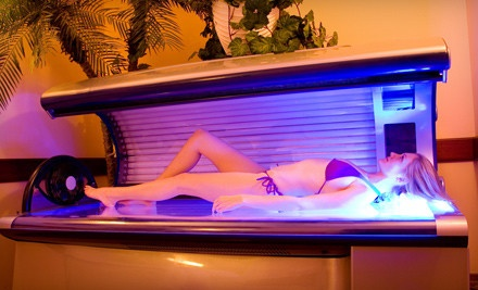 10 UV-Tanning Sessions or Three Mystic Spray Tans at Tropical Dreams Tanning Studio (Up to 68% Off)