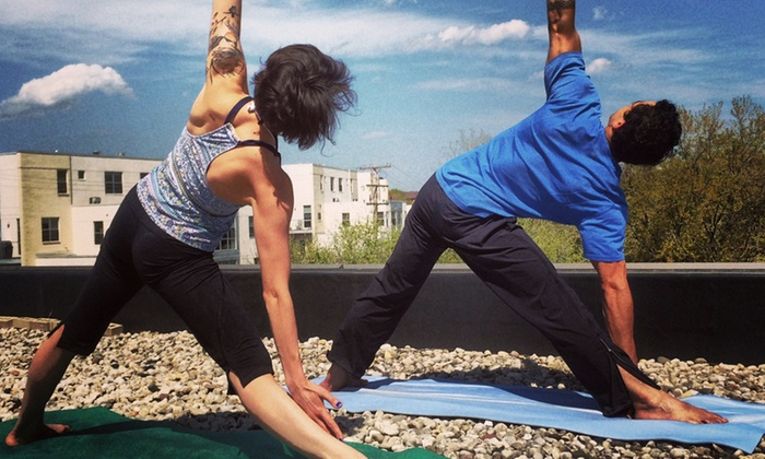 Invivo Wellness - East Side: 10 or 20 Rooftop or Studio Yoga and Fitness Classes at Invivo Wellness (Up to 60% Off)